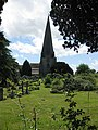 Churchyard, tower and spire - geograph.org.uk - 1397843.jpg