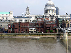 The red-brick City of London School beside the River Thames. St Paul's Cathedral is in the background. The Millennium Bridge is on the right. This view is occasionally seen in popular media e.g. in an early scene of the 2005 movie, The Constant Gardener.