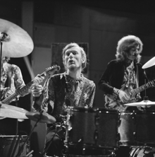 Black and white image of Baker playng an elaborate drum kit