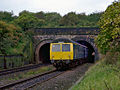 Class 105 M50796 emerges from Farnworth Tunnel.jpg