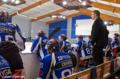Claude Devèze coachant ses joueurs sur le terrain..png