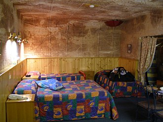 Coober Pedy - Coober Pedy underground motel room, 2007. The upside-down umbrella in the ceiling catches loose dirt that falls down the ventilation shaft from the surface.
