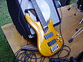 Cort Artisan Bass guitar and amplifier.jpg