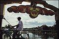 Cyclist on Hội An bridge (14672743434).jpg
