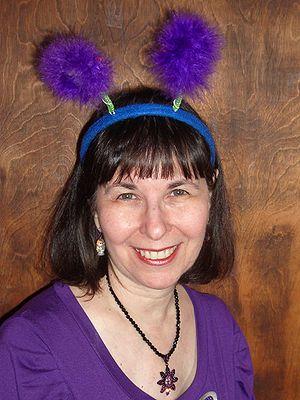 Deely bobber - A woman wearing a deely bobber