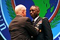 Defense.gov News Photo 110309-D-XH843-003 - Secretary of Defense Robert M. Gates presents the Defense Distinguished Service Medal to outgoing commander of U.S. Africa Command Army Gen.jpg