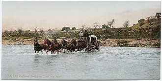 Santa Ynez River - Early Western travelers fording the Santa Ynez River during the turn of the 20th century.