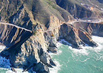 Devil's Slide (California) - Devil's Slide (far left) with the southern portal of the Tom Lantos Tunnels (far right) under construction in late 2010. Note the steep eroded cliffs immediately above and below Highway 1.