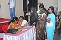 Doctor examining a patient at an ayurvedic medical camp conducted as part of the Bharat Nirman Public Information Campaign, organised by Press Information Bureau, Thiruvananthapuram, at Thrikkunnapuzha, Alappuhza district.jpg