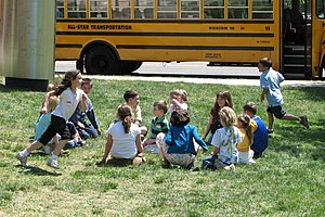 "Children playing ""Duck Duck Goose"", ..."
