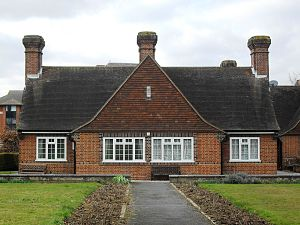 Dyers Almshouses - The houses have large tile-hung gables and chimney-stacks.