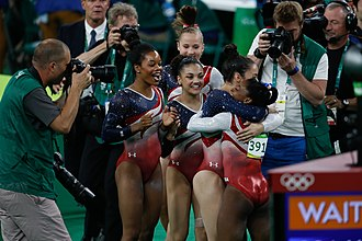 Gabby Douglas - Douglas celebrating with the other Final Five members at the 2016 Olympics Games
