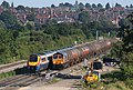 East Midlands Meridian unit 222005 and GBRF CLass 66 770 6E45 Theale-Immingham discharged tanks at Kettering North.jpg