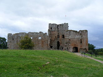 Brougham Castle - The east of Brougham Castle. The gatehouse (right) was built by Robert Clifford, as was the stone wall enclosing the castle. The keep next to the gatehouse is a survival from when Robert de Vieuxpont founded Brougham Castle.