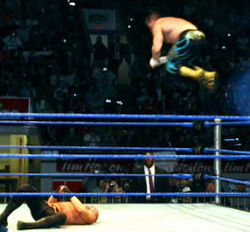 Guerrero giving a Frog Splash during his tag team match with Rey Mysterio against the Basham Brothers during a WWE house show held in Kitchener, Ontario, Canada on January 15, 2005