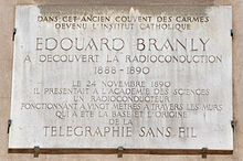 https://upload.wikimedia.org/wikipedia/commons/thumb/9/95/Edouard_Branley_plaque_-_Institut_Catholique_de_Paris_-_rue_Vaugirard,_Paris_6.jpg/220px-Edouard_Branley_plaque_-_Institut_Catholique_de_Paris_-_rue_Vaugirard,_Paris_6.jpg