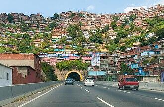 Crisis in Venezuela - Slums in Caracas seen above El Paraíso tunnel