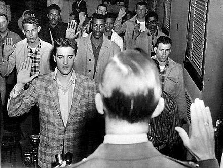 Presley being sworn into the U.S. Army at Fort Chaffee, Arkansas, March 24, 1958 Elvis sworn into army 1958.jpg