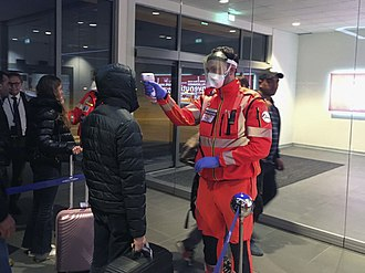 Civil Protection volunteers conduct health checks at the Guglielmo Marconi Airport in Bologna on 5 February. Emergenza coronavirus (49496308758).jpg