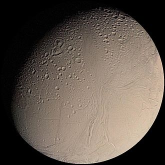 Enceladus - Voyager 2 view of Enceladus in 1981: Samarkand Sulci vertical grooves (lower center); Ali Baba and Aladdin craters (upper left)