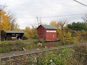Enfield Falls Canal - Windsor Locks Canal Company buildings alongside the canal. Amtrak's New Haven-Springfield Line is visible in the foreground.