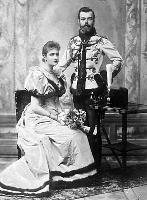 Alexandra Feodorovna (Alix of Hesse) - Tsar Nicholas, in hussar uniform, and Princess Alix of Hesse. Engagement photograph, 1894.