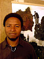 Eric Pina in der Ateliergemeinschaft Helmkestraße Hannover Hainholz 2012 am 15. Zinnober-Kunstvolkslauf Porträt I.jpg