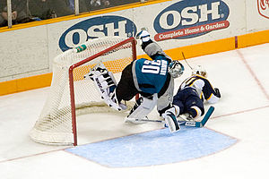 2007–08 San Jose Sharks season - Evgeni Nabokov is crashed into by Martin Erat during a game versus the Nashville Predators.
