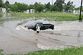 FEMA - 37217 - A resident and a pickup truck going through a flooded street in Texas.jpg