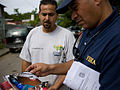 FEMA - 39115 - FEMA Community Relations representative speaks with a resident in Puerto Rico.jpg