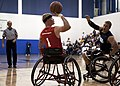 Flickr - Official U.S. Navy Imagery - A Marine prepares to take a shot during a wheelchair basketball game between the Marine Corps and the Navy-Coast Guard at the 2012 Warrior Games..jpg