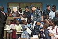 Flickr - Official U.S. Navy Imagery - Sailor hands out school books to children in Nigeria..jpg