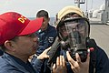 Flickr - Official U.S. Navy Imagery - Sailors get trained on the proper wearing of the self-contained breathing apparatus air cylinder valve assembly during damage control training..jpg