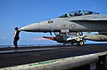 Flickr - Official U.S. Navy Imagery - Super Hornet prepares to move as another jet launches from USS Abraham Lincoln..jpg