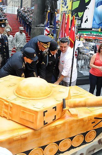 Buddy Valastro - Buddy Valastro (right), General Raymond T. Odierno also other members of the United States Army in Times Square cutting a cake to celebrate the Army's 238th birthday in 2012