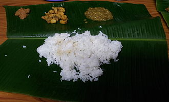 Musa (genus) - Food served on a banana leaf, a traditional way of serving food more popular in southern India