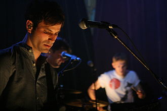 Foster the People - Sean Cimino (front) with the group at the Bluebird Theater in June 2011.
