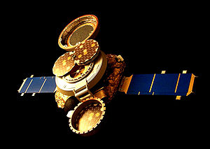 An image of a spacecraft, with two solar panels on either end, and a collection system in the open position, visible on the top of the spacecraft, with the lid open.