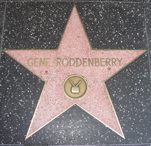 "A star shaped paving slab, with the words ""Gene Roddenberry"" above the middle."