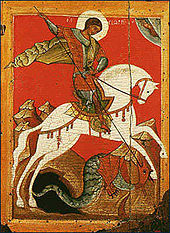Icon of man in armour on white horse fighting black dragon to his left.