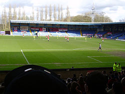Gigg Lane stadium, England. View on the field from Manchester Road end.jpg