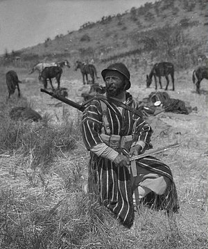 "Moroccan Goumier - A ""Goum"" featured in Yank magazine, shown sharpening his bayonet."