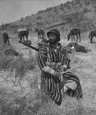 Royal Moroccan Army - Moroccan Goumier sharpening his bayonet, Italy 1944