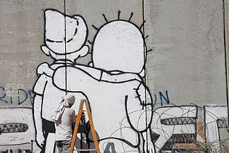 Geneva Initiative (2003) - The Peace Kids, a mural affiliated with the Geneva Initiative on the Israeli West Bank barrier depicting Palestinian Handala and Israeli Srulik embracing one another.
