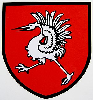 Grue blanche sur fond rouge, blason du district de la Gruyère