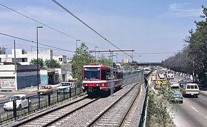 Guadalajara LRV in median of Avenida Colón, north of Unidad Deportiva station in 1990