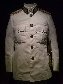 White tropical dress (colonial service, 1st class) of the Gubernatorial uniform worn by Governor Edward Youde on the day he sworn in and numerous official ceremonies during his tenure, Hong Kong Museum of History. HK History of HK Museum Uniform of HK Governor Edward Youde.JPG