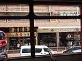 HK Tram tour view Causeway Bay 怡和街 Yee Wo Street August 2018 SSG 12 shops.jpg