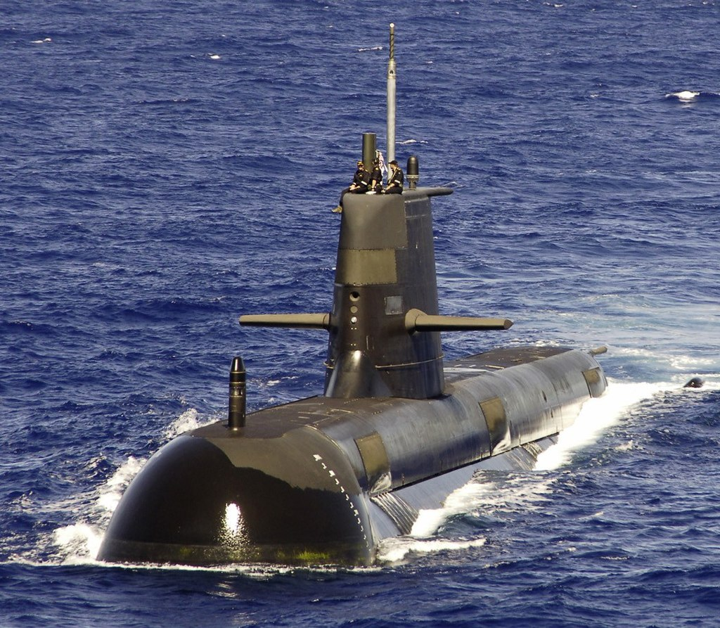A large submarine travelling on the surface of the ocean.