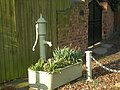 Hand-pump and re-employed water trough - geograph.org.uk - 696454.jpg